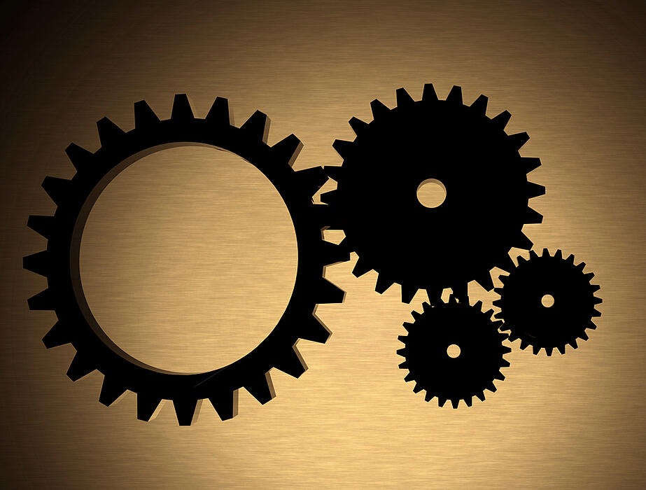 cogwheels over a gold metal texture made in 3d with high quality detail